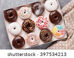 Постер, плакат: Colorful donuts box on