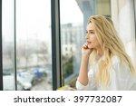beautiful blonde woman sitting... | Shutterstock . vector #397732087