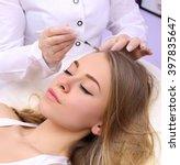 female beautician makes... | Shutterstock . vector #397835647