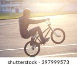 man riding a bicycle motocross... | Shutterstock . vector #397999573