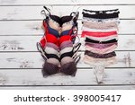 lace panties and bra on wooden... | Shutterstock . vector #398005417