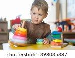 little caucasian boy plaing... | Shutterstock . vector #398035387