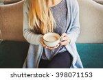 cup of coffee in female hands... | Shutterstock . vector #398071153