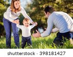 parents holding their little... | Shutterstock . vector #398181427