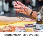 woman draws mehendi on the... | Shutterstock . vector #398199283