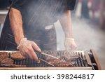 Chef  Preparing Burgers At The...