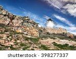 ancient windmill on the ridge ... | Shutterstock . vector #398277337