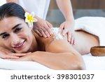 woman enjoying a salt scrub... | Shutterstock . vector #398301037