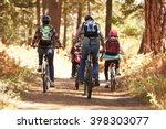 family mountain biking on... | Shutterstock . vector #398303077
