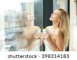 beautiful blonde woman standing ... | Shutterstock . vector #398314183