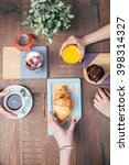close view of hands taking food ... | Shutterstock . vector #398314327