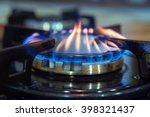 blue flames on gas stove burner