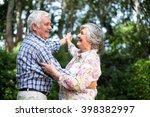 cheerful senior couple dancing... | Shutterstock . vector #398382997