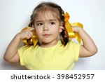 cute little girl with yellow... | Shutterstock . vector #398452957