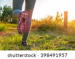 fitness girl running at sunset... | Shutterstock . vector #398491957