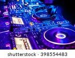 dj mixer with headphones at... | Shutterstock . vector #398554483