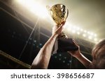 athlete holding trophy cup | Shutterstock . vector #398656687