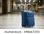 Large Blue Wheeled Suitcase...