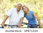 senior couple on cycle ride in... | Shutterstock . vector #39871324