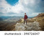 man on top of mountain.... | Shutterstock . vector #398726047