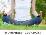 beautiful woman doing yoga... | Shutterstock . vector #398739367