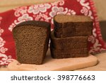 loaf of bread and rye ears... | Shutterstock . vector #398776663