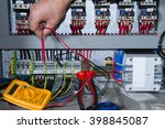 electrician at work with an... | Shutterstock . vector #398845087