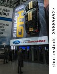Small photo of NEW YORK, USA - MARCH 23, 2016: Ford Shelby GTH hangs over the entry to the New York International Auto Show at the Jacob Javits Center.