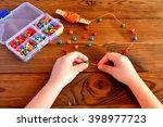 Children Hands Holding Beads...