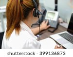 Small photo of close up focus on headphone of asian call centre response answer or use telephone working in operation room concept.