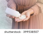 women hand apply talcum powder | Shutterstock . vector #399538507