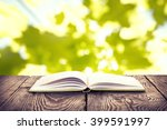 open book with green cover on