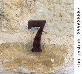 Rusted House Number Seven On A...