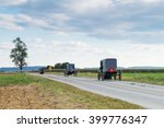 Three Amish Carriages Along A...