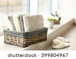 Towels In Wicker Basket With...