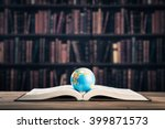 heavy book and globe | Shutterstock . vector #399871573