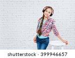 teenage girl wearing headphones | Shutterstock . vector #399946657