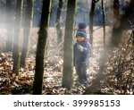caucasian boy playing outdoor.... | Shutterstock . vector #399985153