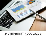 tablet computer and financial... | Shutterstock . vector #400013233