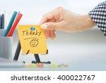 human hand holding adhesive...   Shutterstock . vector #400022767