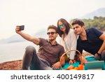 three friends having fun at the ... | Shutterstock . vector #400149817