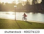 Happy Girl Drives On Bike Near...
