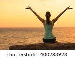 woman enjoying the ocean view. | Shutterstock . vector #400283923