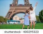 adorable little girls in paris... | Shutterstock . vector #400295323