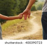 a the parent holds the hand of... | Shutterstock . vector #400390723