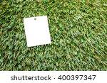 paper labels on artificial grass | Shutterstock . vector #400397347