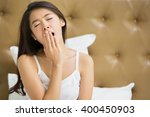 asian women are yawning after... | Shutterstock . vector #400450903