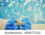 flip flops by the swimming pool | Shutterstock . vector #400477123