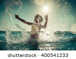 happy child playing in the sea. ...