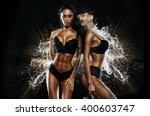 sexy twins in water splash | Shutterstock . vector #400603747